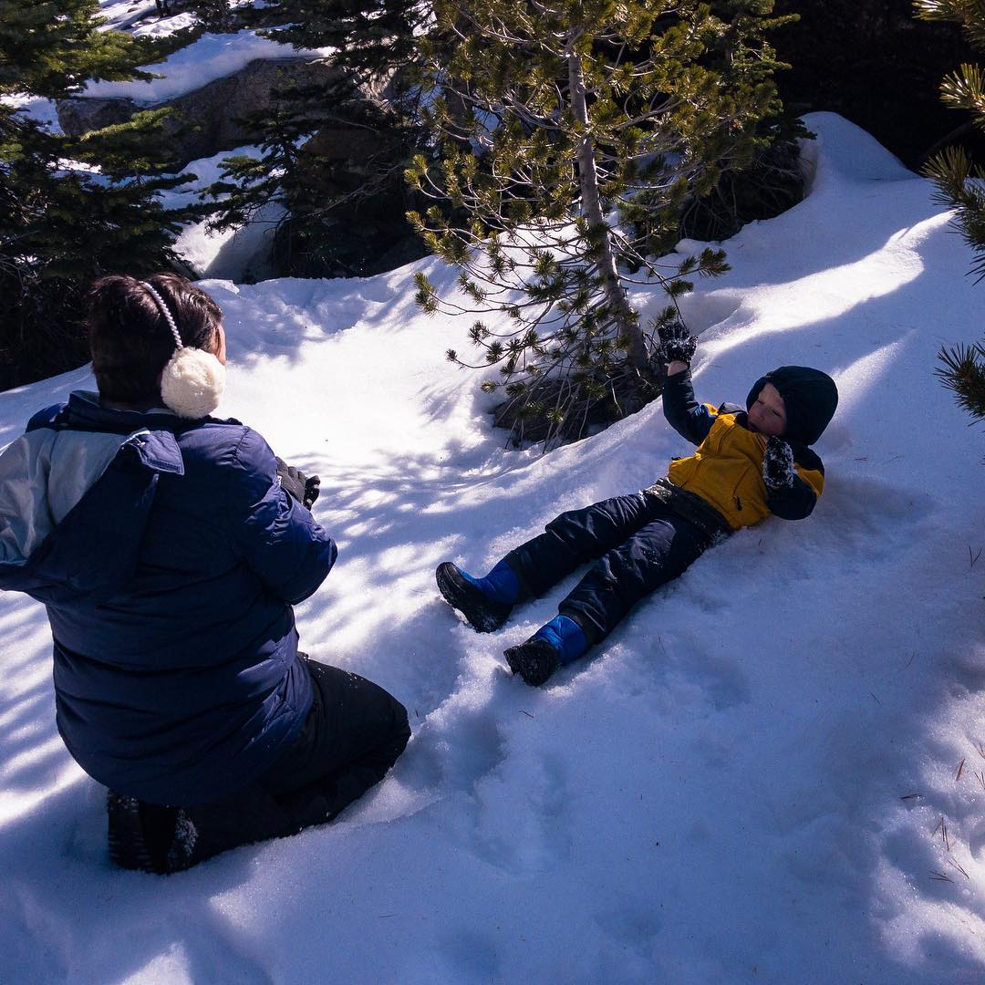 Drew learning to make his very own snow angel